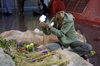 central bus station, performance, garbage, flowers, parallel world